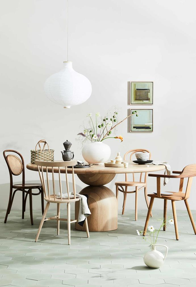 Take a playful approach to your dining area with complementary mis-matched chairs.