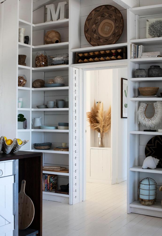 Custom built-in storage shelves allows the family to showcase their treasures.