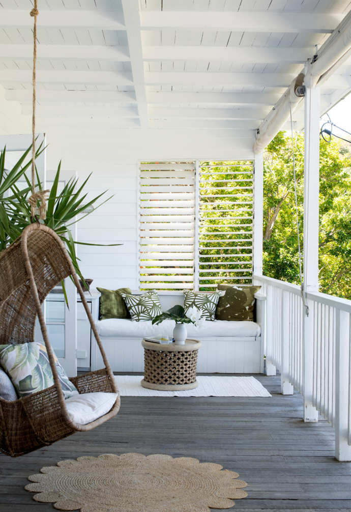"""The star of this space, off Mati's room and the guest bedroom, is Monique's original design for the Malawi Cane single hanging chair. """"It was the prototype that I brought in for the first trade show, so it's the one that's never going to leave us,"""" says Monique, who has accessorised this relaxing outdoor zone with a 'Bamileke' table sourced from Africanologie sitting atop a cotton rug from Home On Darley."""