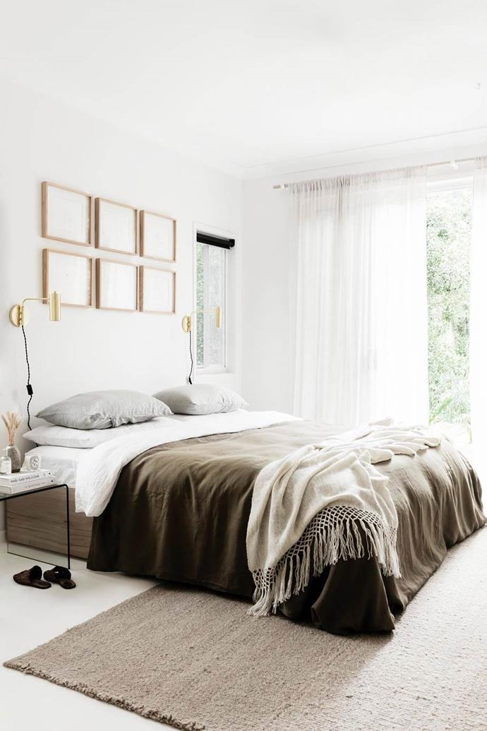 "Positioning your bedroom furniture half-on and half-off will help to anchor the space as well as making it feel much larger as opposed to squishing all the furniture on top of the rug. This olive toned bedroom in a [creative couple's relaxed Byron Bay home](https://www.homestolove.com.au/a-byron-bay-home-filled-with-handcrafted-finds-19045|target=""_blank"") is the perfect example of how a simple rugs pairs well with contemporary boho style."