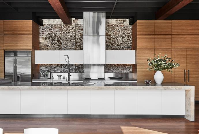 The ceiling beams and flooring are made from ironbarks salvaged from the Hornibrook Bridge, sourced through Australian Architectural Hardwoods. Concrete benchtop, Concrete by Design. Internal cabinet hardware, Blum. Tapware, Gessi. Bowl, The DEA Store.