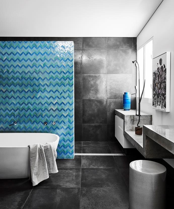 A wall tiled with Moroccan tiles in a herringbone pattern conceals a generous walk-through shower. Wall and floor tiles, Academy Tiles. Apaiser bath, Rogerseller. Stool, Ondene. Speculo 18 artwork by James McGrath, Olsen Gallery.