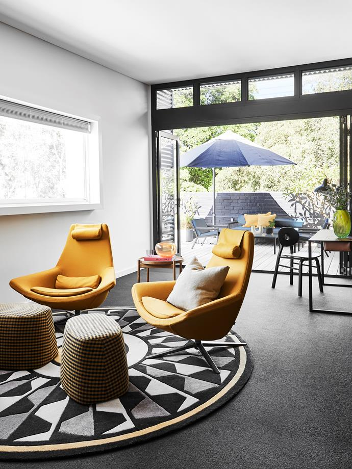 """""""This is where we tend to chill out of an evening,"""" Suzi says of this small living space off the bedroom, which includes a Greg Natale rug topped with B&B Italia swivel armchairs and footrests from Space. Desk and chair, Cult."""