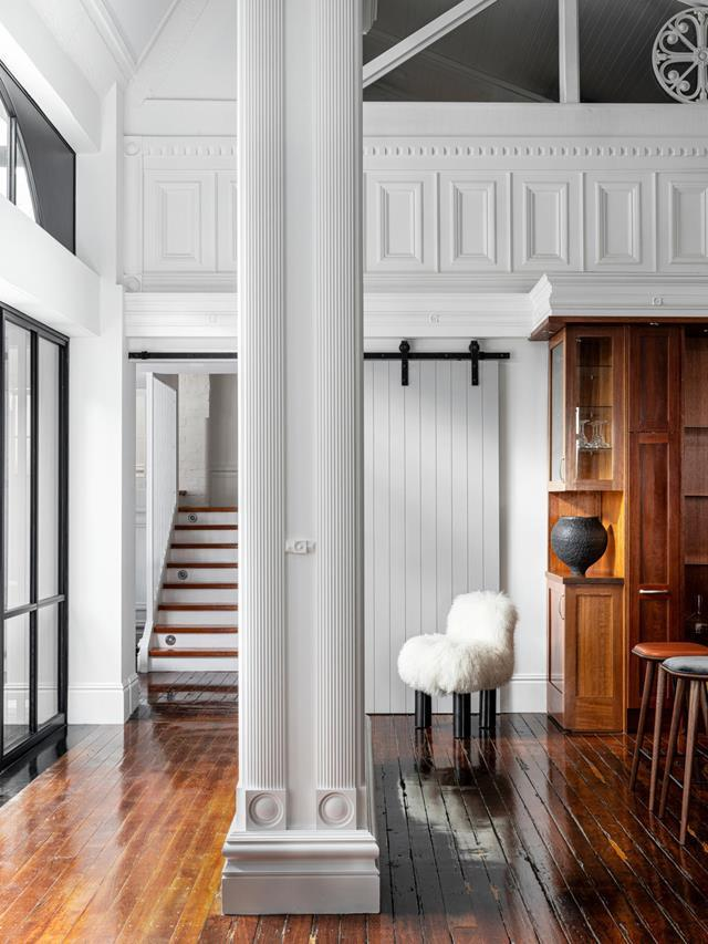 "Embracing the columns and stained-glass windows from an earlier time, a fresh makeover inserts a desired layer of sophistication and intimacy to this [warehouse home](https://www.homestolove.com.au/converted-warehouse-home-21349|target=""_blank""). The inspired renovation has been a breath of fresh air to a one-time trouser factory. It strides out with a new-found confidence, thanks to architect Josephine Hurley."