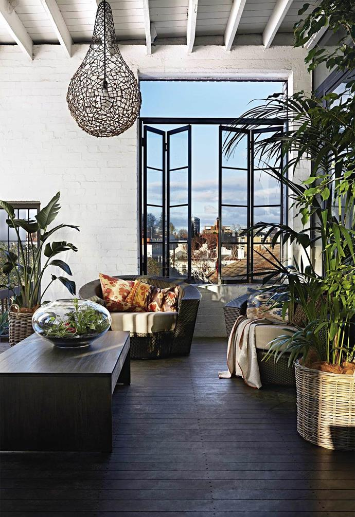 "After coveting this [warehouse apartment](https://www.homestolove.com.au/creative-warehouse-conversion-melbourne-21952|target=""_blank"") for years, the owners have now made it a home that revives the building's heritage with a modern twist. The indoor deck connects the home to the outside all year round."