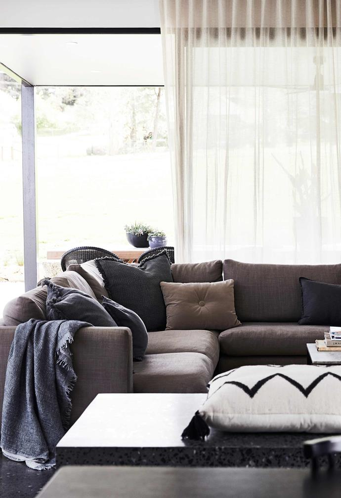 """**Living area** Breeze-friendly windows and a fireplace make this the place to be all year. Custom sofa. Curtains, The Curtain Theatre, using linen from [Fabric House](https://www.fabrichouse.com.au/