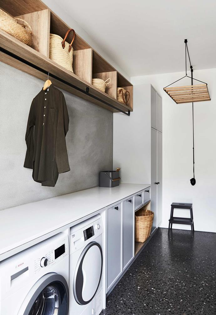 """**Laundry** This space is luxuriously large, and its white walls and dark floor link it to the overall scheme. Benchtop, Caesarstone Pure White. Tiles, [Di Lorenzo](https://dilorenzo.com.au/