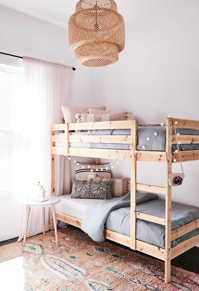 """**Kid's room** Ikea provided the bunk beds, pendant light and curtains. Side table, [Adairs](https://www.adairs.com.au/