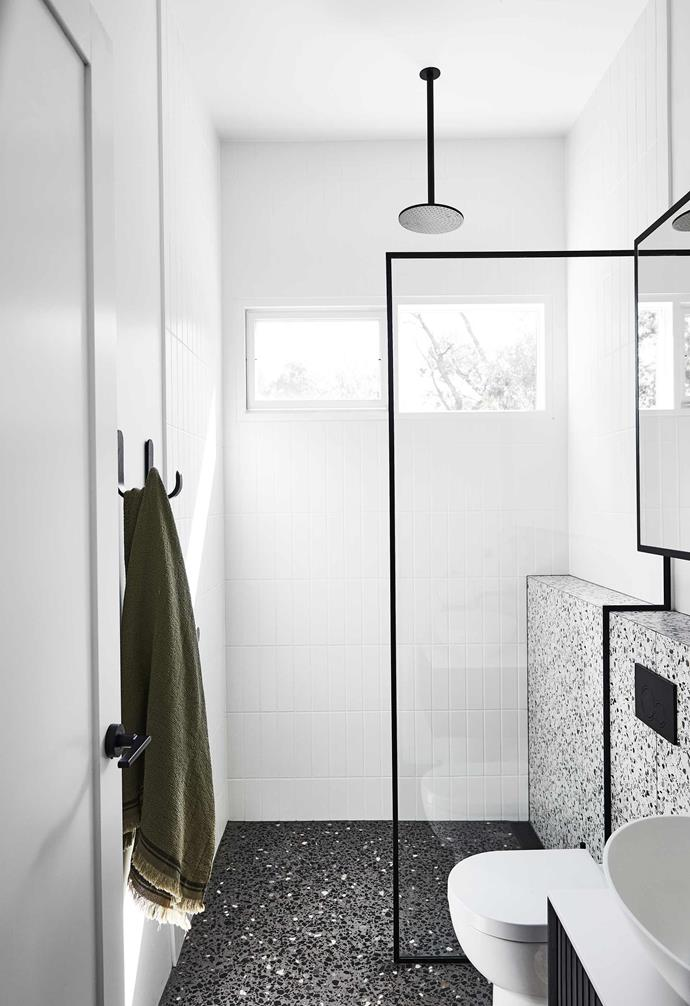 """**Main bathroom** The black-framed screen lines up with the polished concrete floor and tiles from [Art Of Tiles](https://www.artoftiles.com.au/