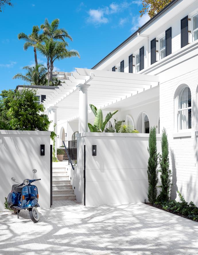 Constructed by M&G Building, the house has a traditional look and is painted in Dulux 'Natural White' with shutters in Dulux 'Black Caviar'. Granite cobblestones from Marble & Ceramic Corp.