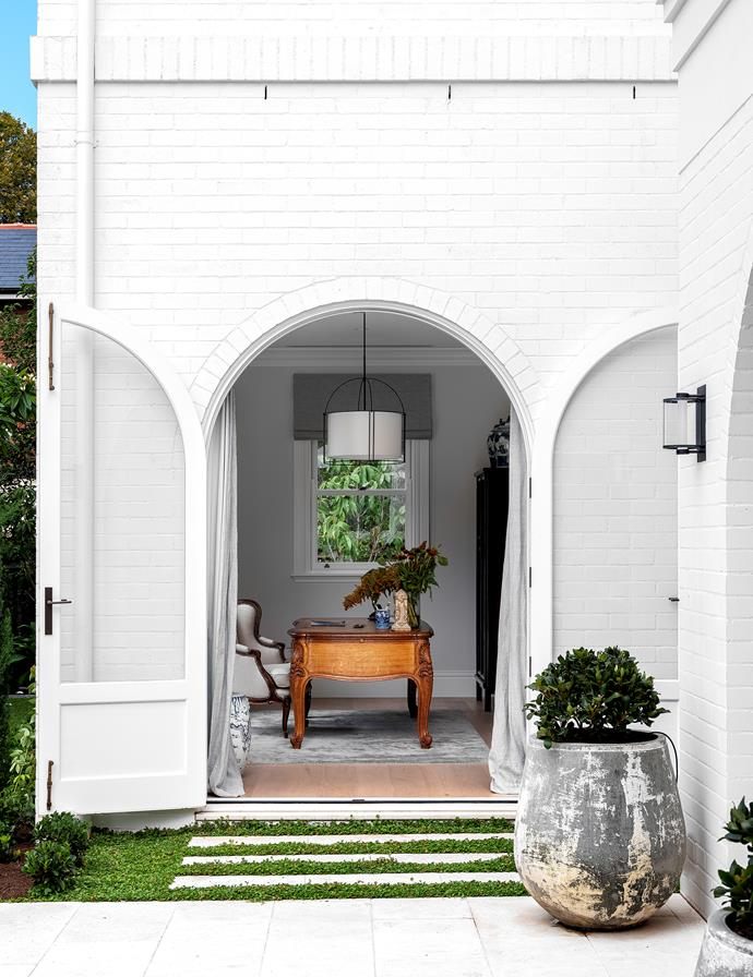 Arched doors lead from all the ground-floor rooms to the garden. External wall lights by Nocturnal Lighting from Koda Lighting.