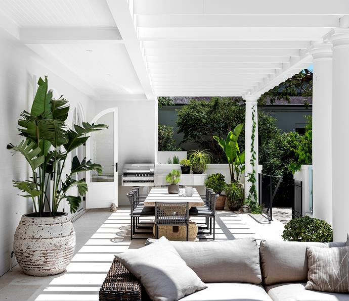 The outdoor terrace is furnished with a 'Balsa' modular lounge from Eco Outdoor. Outdoor table from Yardware with dining chairs from Harbour 1976. Limestone paving from Marble & Ceramic Corp.