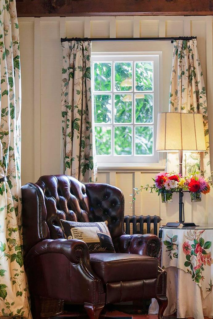 Floral drapes create a welcoming sitting area.