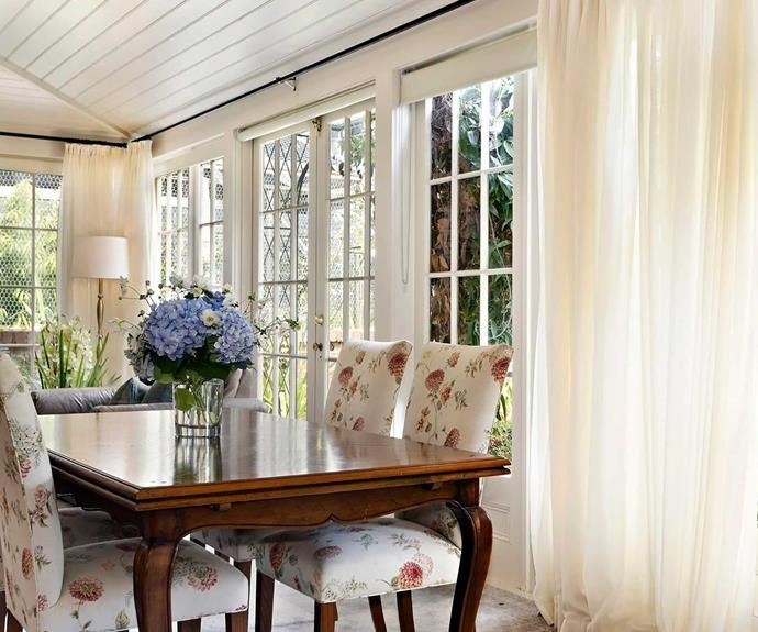 Most rooms in the home overlook the stunning garden, and the bright and airy dining room is no exception.