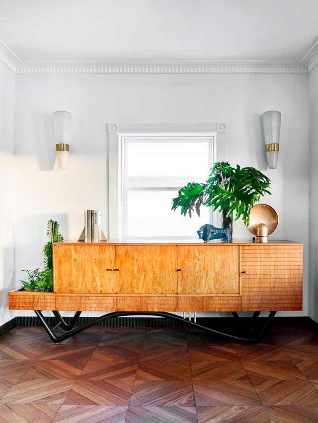 """A 1950s 'Bossa Nova' credenza by Giuseppe Scapinelli sits in the living room of this [Latin-inspired penthouse](https://www.homestolove.com.au/(https://www.homestolove.com.au/makeover-of-an-art-deco-apartment-in-bondi-6291