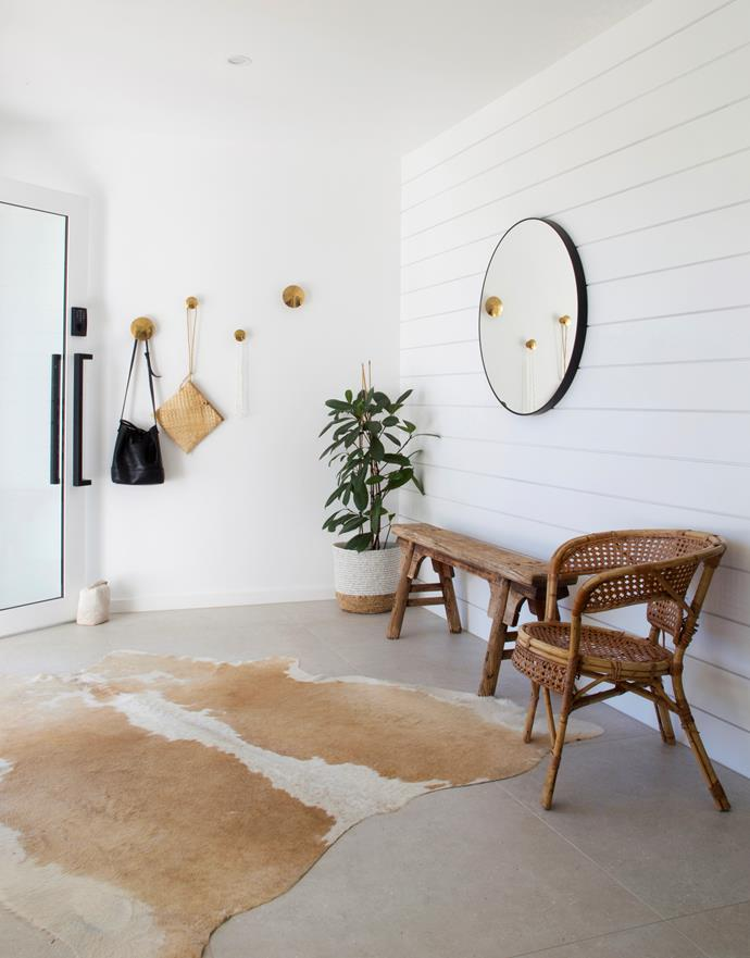 Soft curves of a round mirror add to the relaxed vibe while vintage pieces in natural materials instantly add character.
