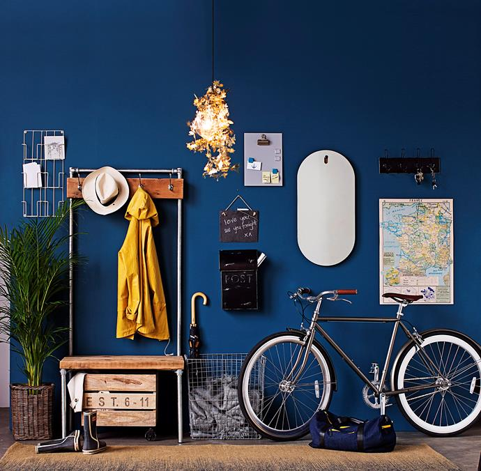 The vibrant wall is a great background for the eclectic mix of objects.