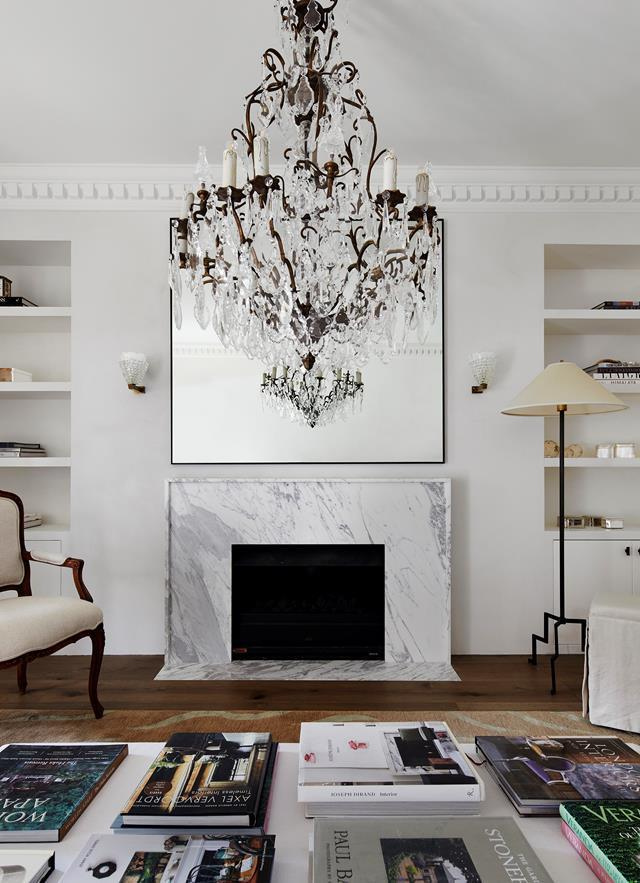 "Phoebe Nicol created bespoke pieces in the living and reading room of this [French-inspired home](https://www.homestolove.com.au/elegant-home-french-inspired-interior-sydney-22184|target=""_blank""), including a hand-knotted rug, ottoman, mirror and fireplace surround in Statuario marble."