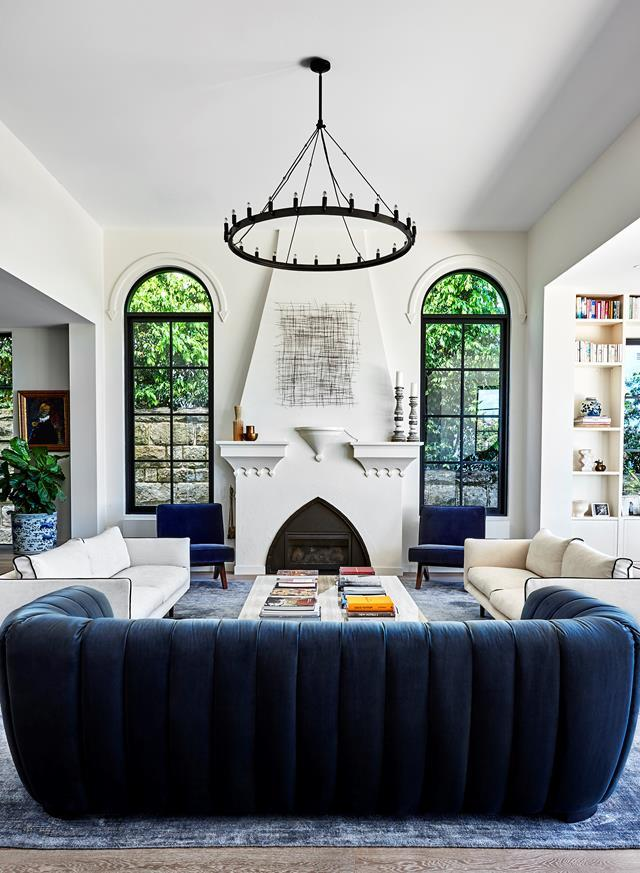 "Challenged with making over her own [period villa home](https://www.homestolove.com.au/restored-1920s-meditteranean-villa-22124|target=""_blank""), interior designer Olivia Babarczy played up the Mediterranean features and airy mood of the 1920s original with a palette of subtle tones and carefully curated pieces. The focal point of the living room, the original arched fireplace announces its Spanish heritage."