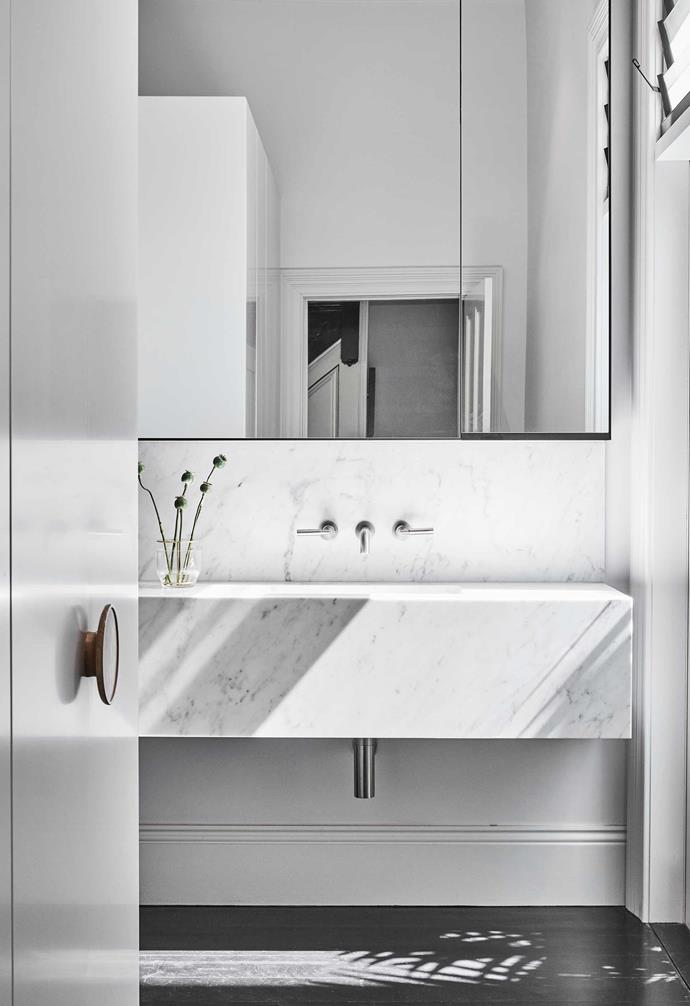 """**Ensuite** Carrara marble also features here and space is maximised by the mirrored cabinet. American oak handles, [Kurv Living](https://kurvliving.com.au/