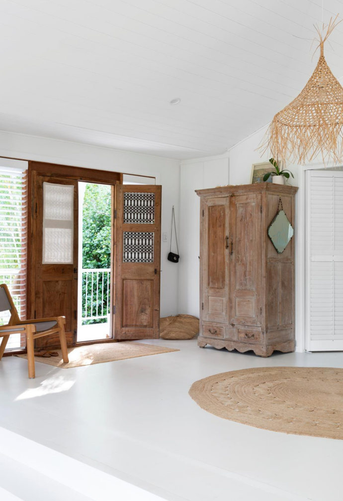 Antique doors from Eclectic Style frame the front door.