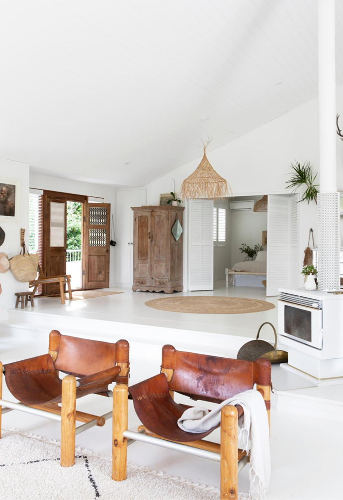 """Warm tones define the [home's entry](https://www.homestolove.com.au/hallway-ideas-1811