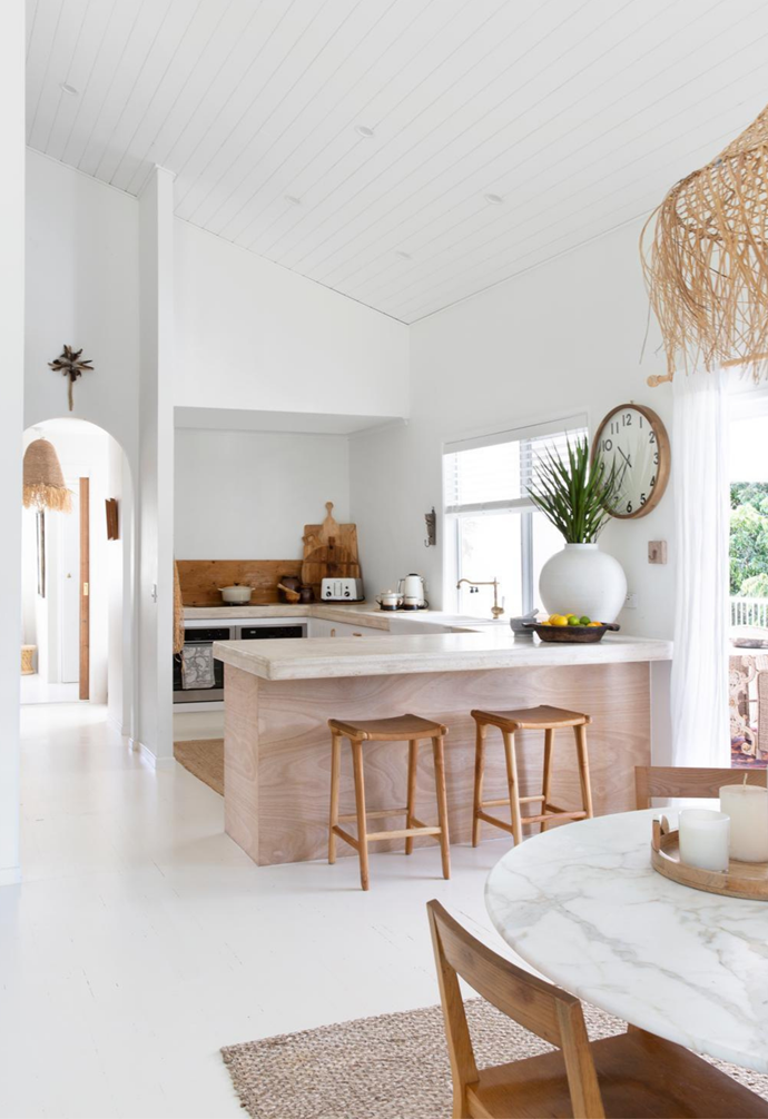 """""""The natural colour of the timber was beautiful, but I really wanted to go all-white and it completely transformed the place,"""" says Andy, who opted for Dulux Lexicon Quarter. """"We even had all the windows, sliding door frames and balustrades spray-painted white, which made the greenery outside pop."""""""