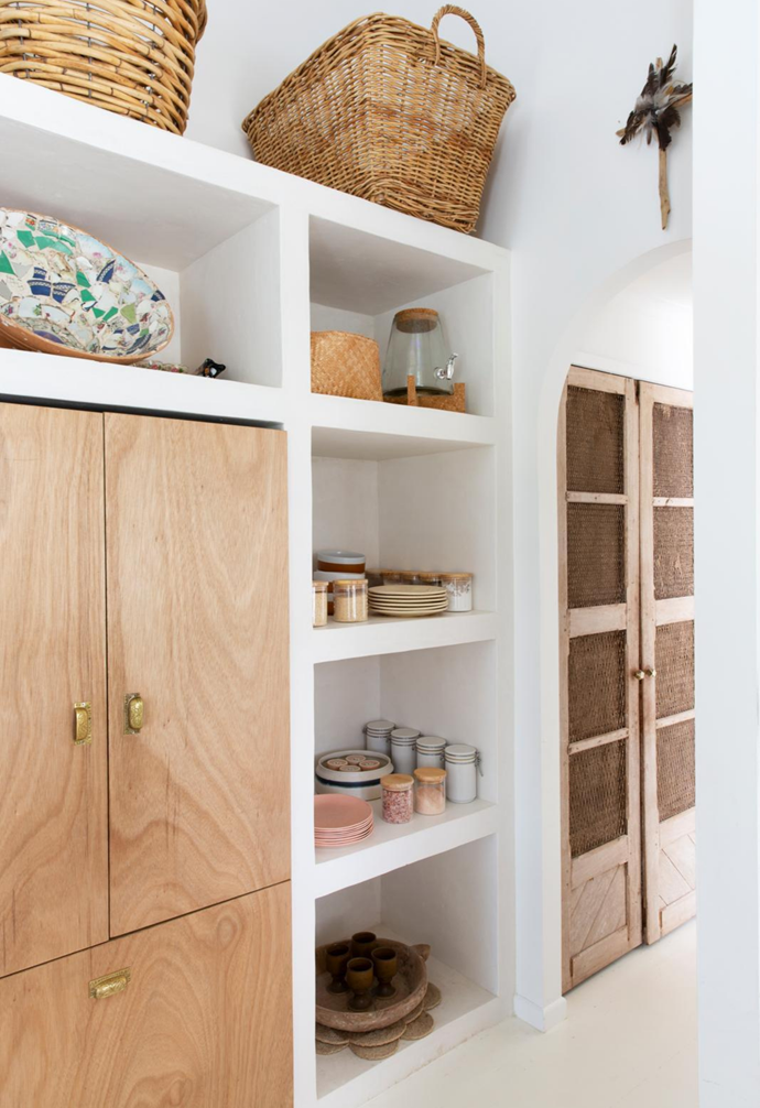 Vintage doors, also sourced from Eclectic Style, were the perfect fit for the pantry space in the kitchen.