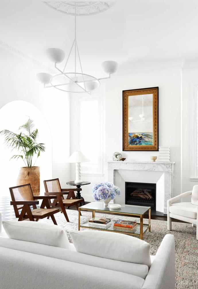 """In the living room of this [Mediterranean-inspired apartment](https://www.homestolove.com.au/harbourside-apartment-with-mediterranean-inspired-interiors-21624