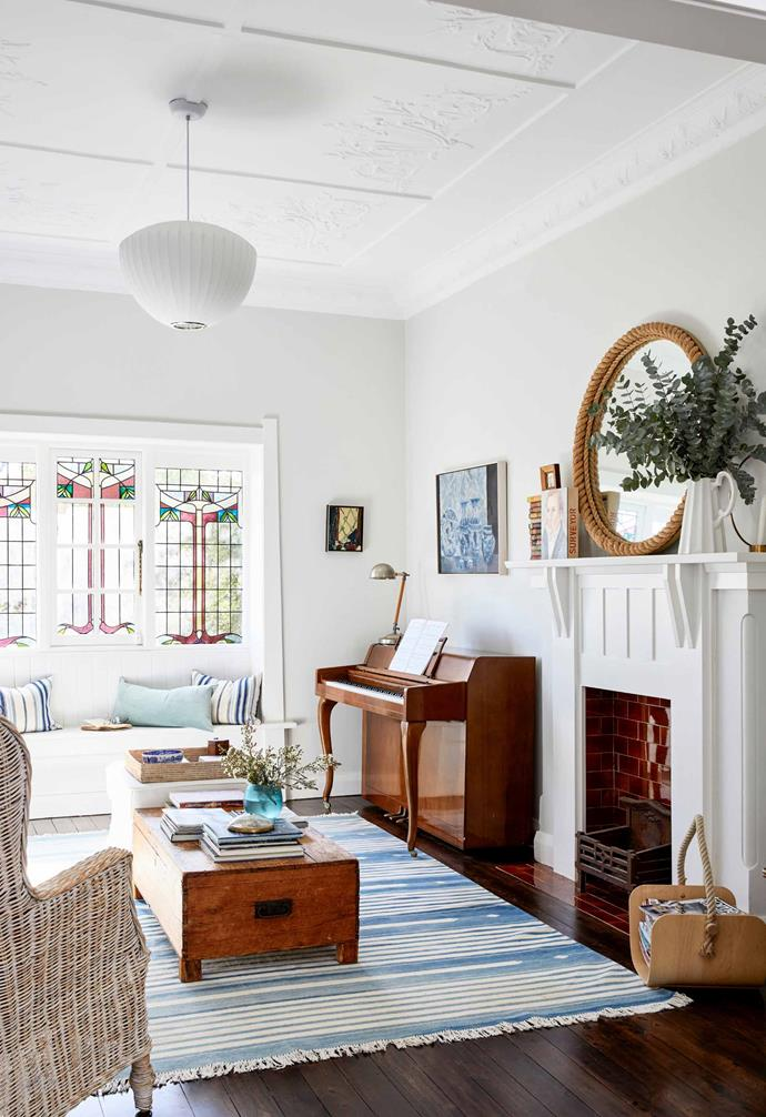 The original fireplace in this renovated heritage home in Sydney is the perfect place to gather round throughout the cooler months.