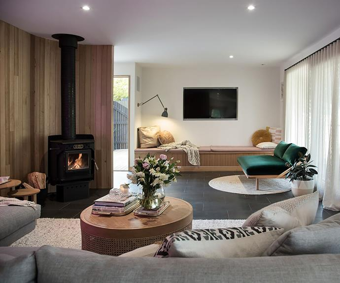 A curved, panelled feature wall creates a calm and cosy living space.