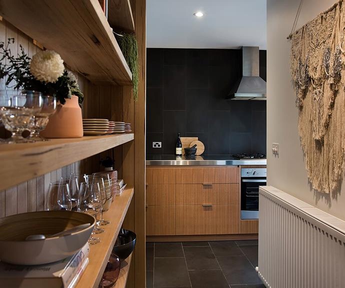 The entertainer's kitchen is well-equipped with stainless steel appliances and an abundance of crockery.