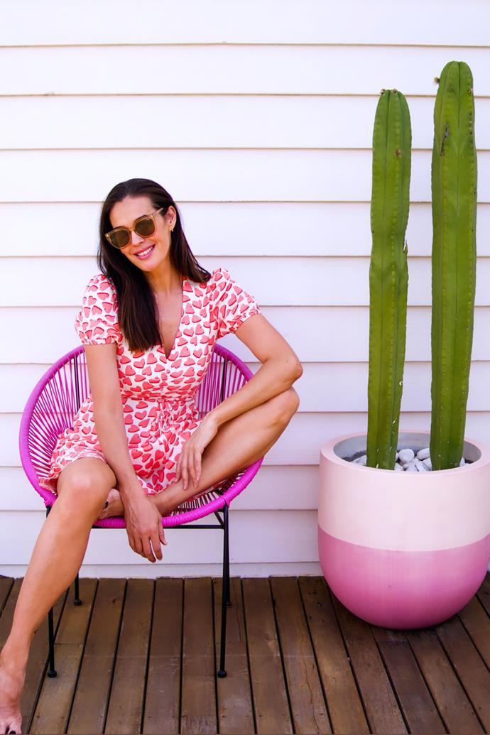 Megan Gale relaxes on the deck of Dollywood.