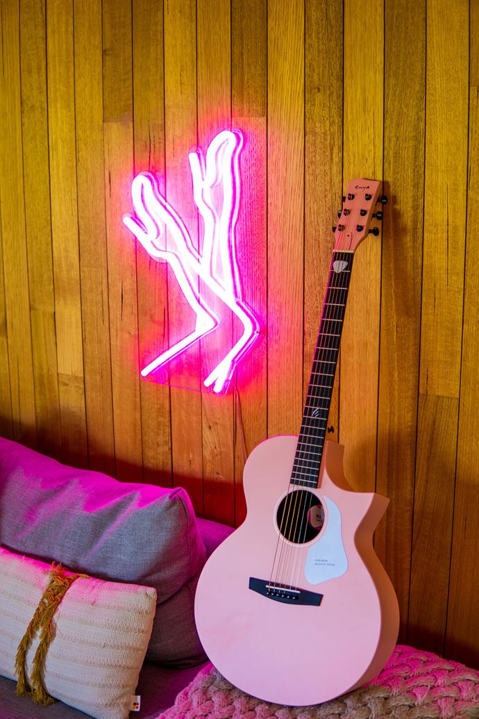 Neon signs and nods to Dolly Parton can be found throughout the home.