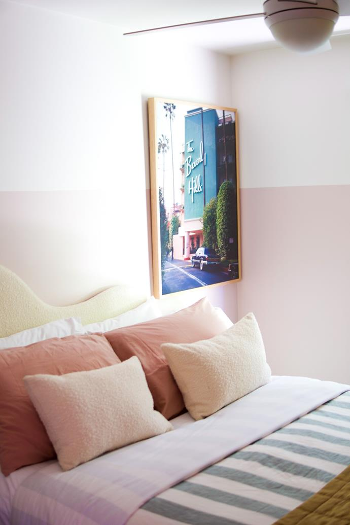 """A bedroom in Dollywood, styled with pastel-pink bedding and [boucle cushions](https://www.homestolove.com.au/boucle-furniture-21234