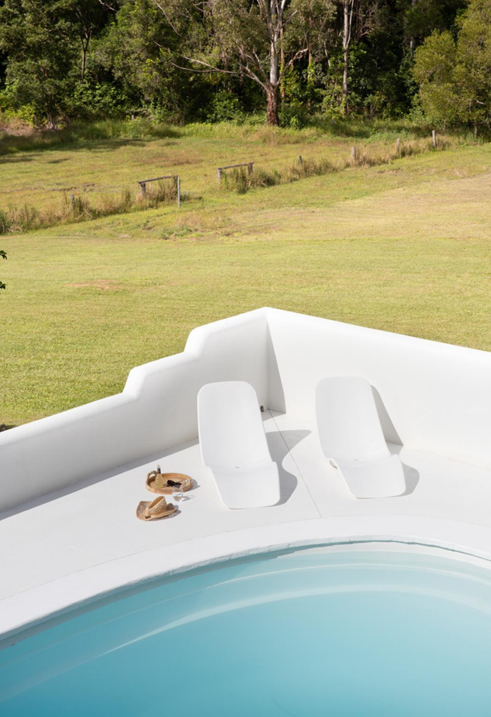 The Santorini- inspired pool is the ultimate splash zone with moulded walls and 'Slip In' sun loungers from Techno Plastics, while at the back, a butterfly staircase is reminiscent of an old Queenslander.
