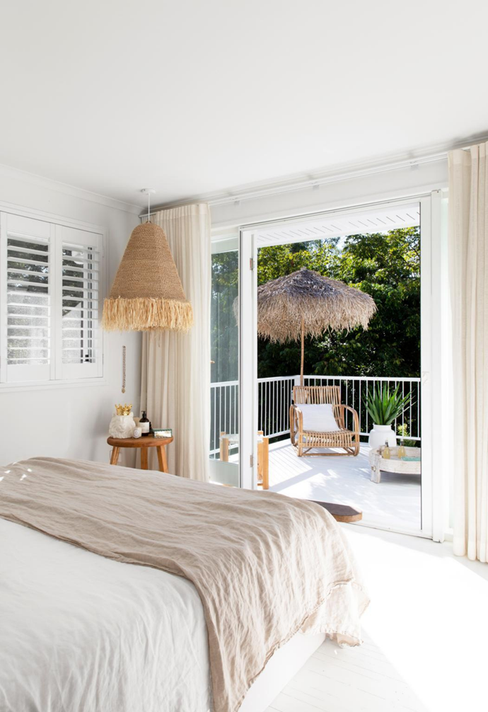 Stephen and Andy's bedroom is a serene, sun-drenched haven. Dressed simply in layers of white and cream, it's a timeless retreat, with timber elements such as a vintage bench providing a touch of warmth.