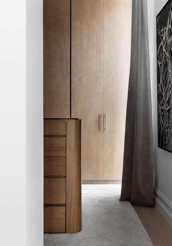 Custom wardrobe with Joseph Giles handles from The English Tapware Company. Artwork by Andrew Brown. Rug from Whitecliffe Imports.