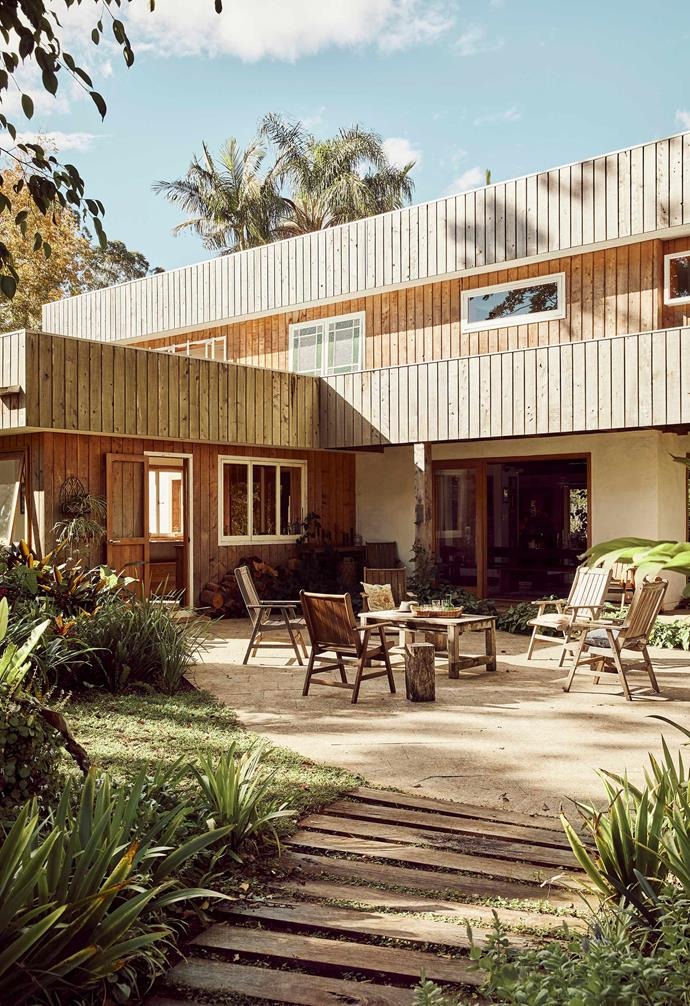 """Nestled on the outskirts of Byron Bay, [this former macadamia farm houses a revamped red-brick abode](https://www.homestolove.com.au/recycled-timber-home-sustainable-21272