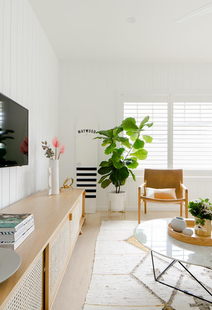 """With its denim 'Hugo' sofa from Lounge Lovers, sandy-hued Kira & Kira 'The Iconic' sideboard and sunshine-yellow Smithmade cushion, the [lounge room](https://www.homestolove.com.au/living-room-essentials-3466 target=""""_blank"""") takes colour cues from its seaside locale."""