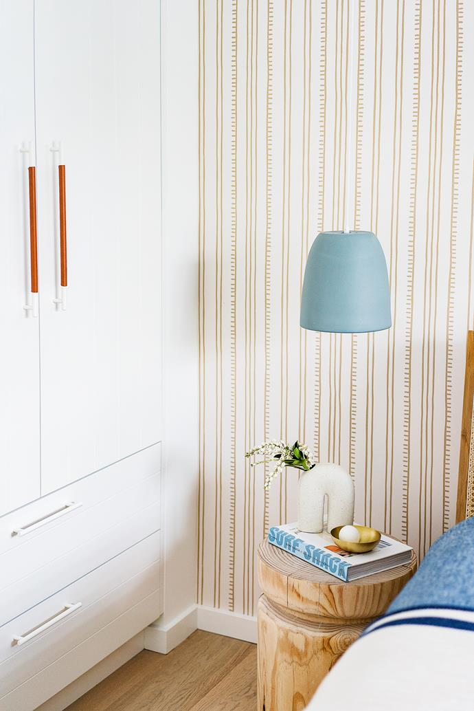 """""""If a piece is made locally it's more likely to be sustainably sourced and ethically produced,"""" says Simone of her decorating ethos. """"And when we have guests visiting from overseas it's nice for them to experience Australian design."""" Anna Spiro 'Higgledy Piggledy Stripe' wallpaper, Porter's Paints."""