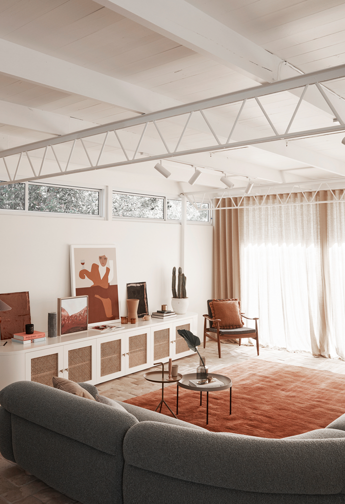 "In the [lounge area](https://www.homestolove.com.au/lounge-room-ideas-21182|target=""_blank""), an Egyptian rug in Russet from Armadillo and an Asla cushion in Ochre from Country Road help establish one of the home's most striking colour schemes."