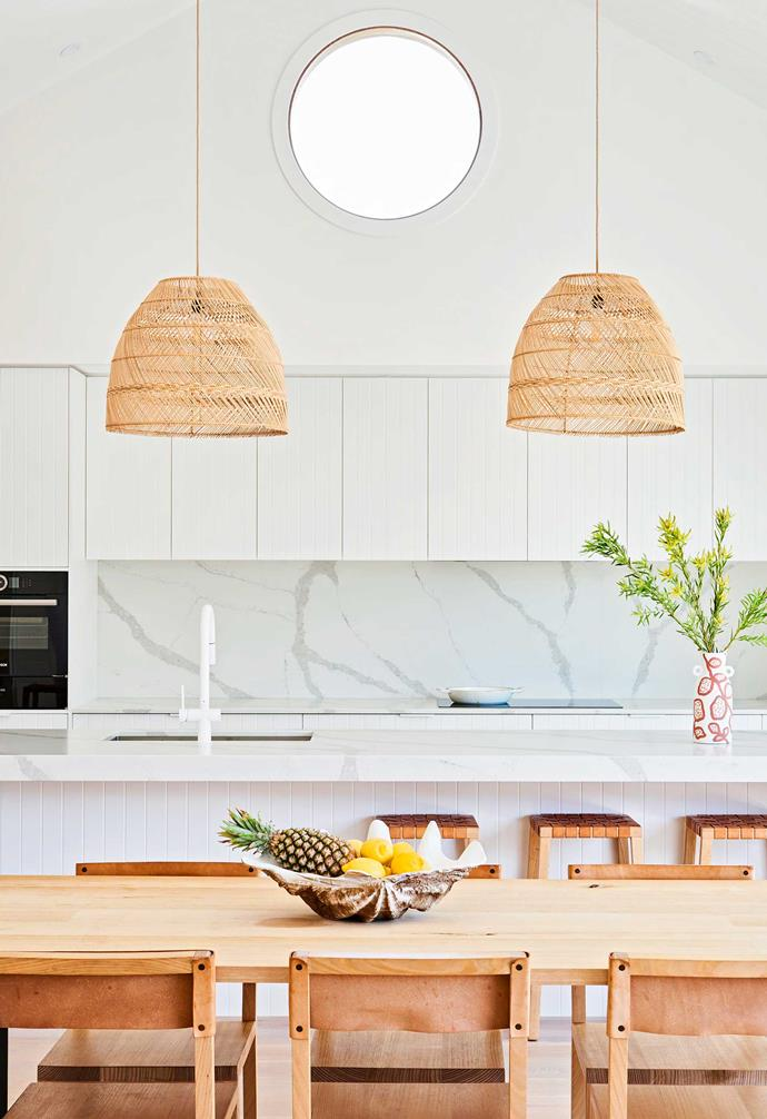 """**Kitchen/dining** """"The best space in our home is the beautiful combined kitchen, dining and living area,"""" says Briony. """"The round windows are inspired by the original house and we've used them throughout."""" Borghini Naturale quartz benchtop and splashback from [Smartstone](https://www.smartstone.com.au/