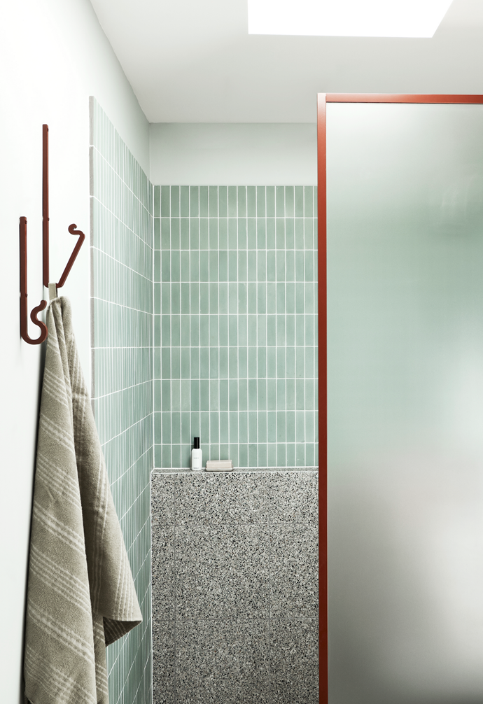 In the bathroom, distinctive mint-green Matt Square shower tiles from Classic Tiles complement the home's overall colour scheme, while conveying cleanliness and freshness.