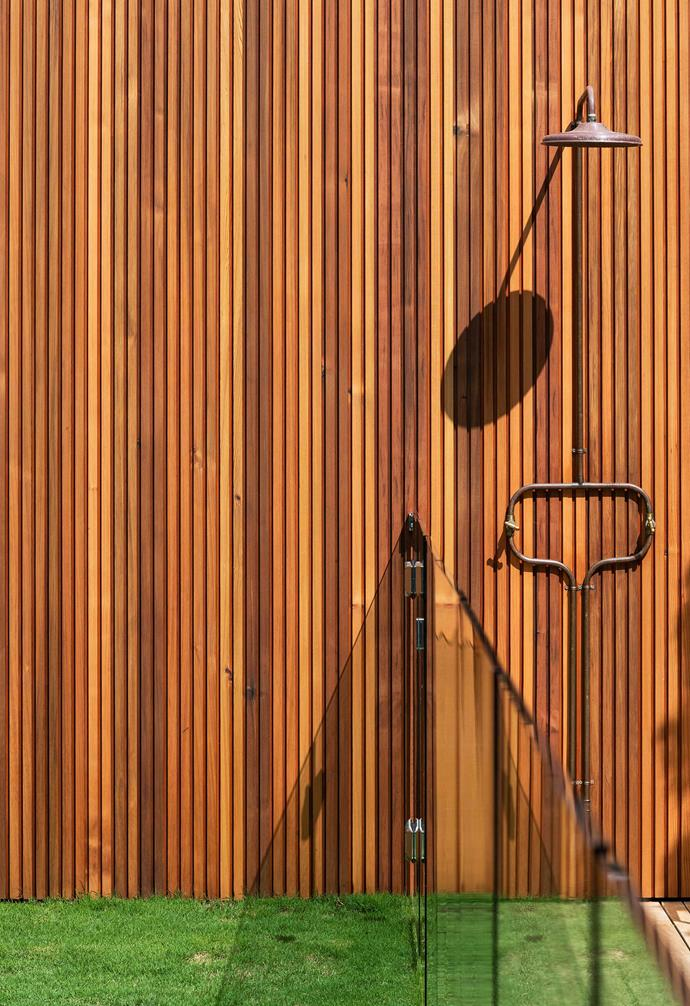 """The cedar screen at the rear hides the garage and provides a backdrop for the striking Murray Rose outdoor shower from [Robert Plumb](https://robertplumb.com.au/