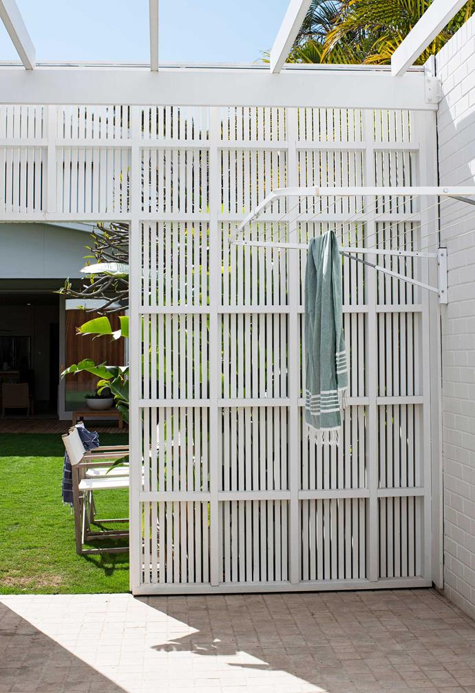 """Screening is used to great effect, in this case to separate the garden's various elements, including the lawn and pool. Hills 'Everyday' wall-mounted clothes line from [Bunnings](https://www.bunnings.com.au/