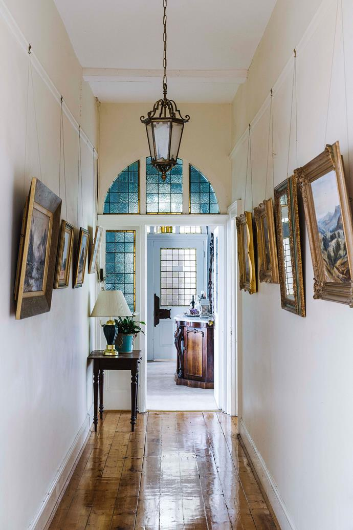 The attractive hallway is lined with artwork.
