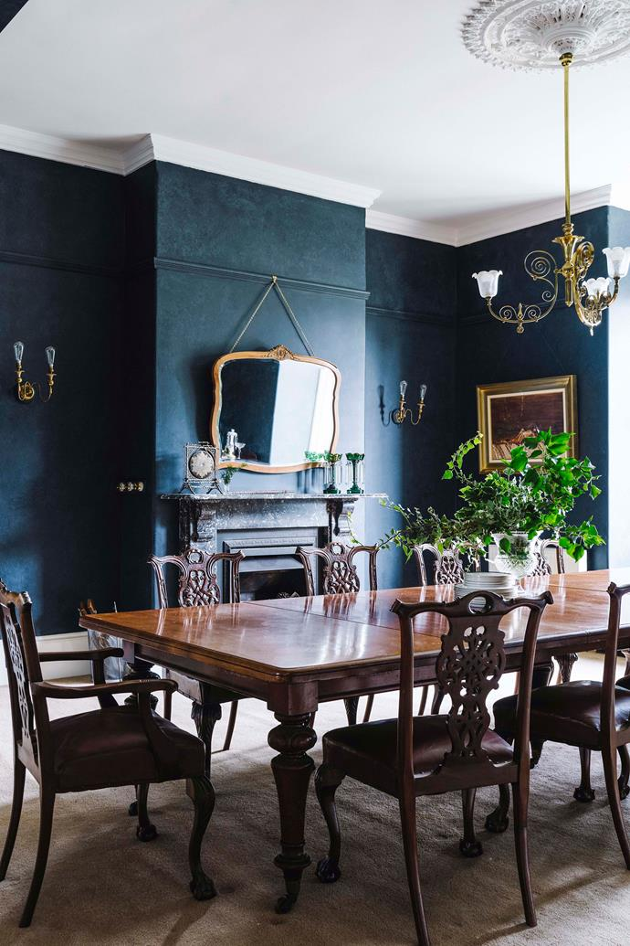 """The dramatic dining room, painted in [Porter's Paints Blue Steel](https://shop.porterspaints.com/paint/trim/blue-steel