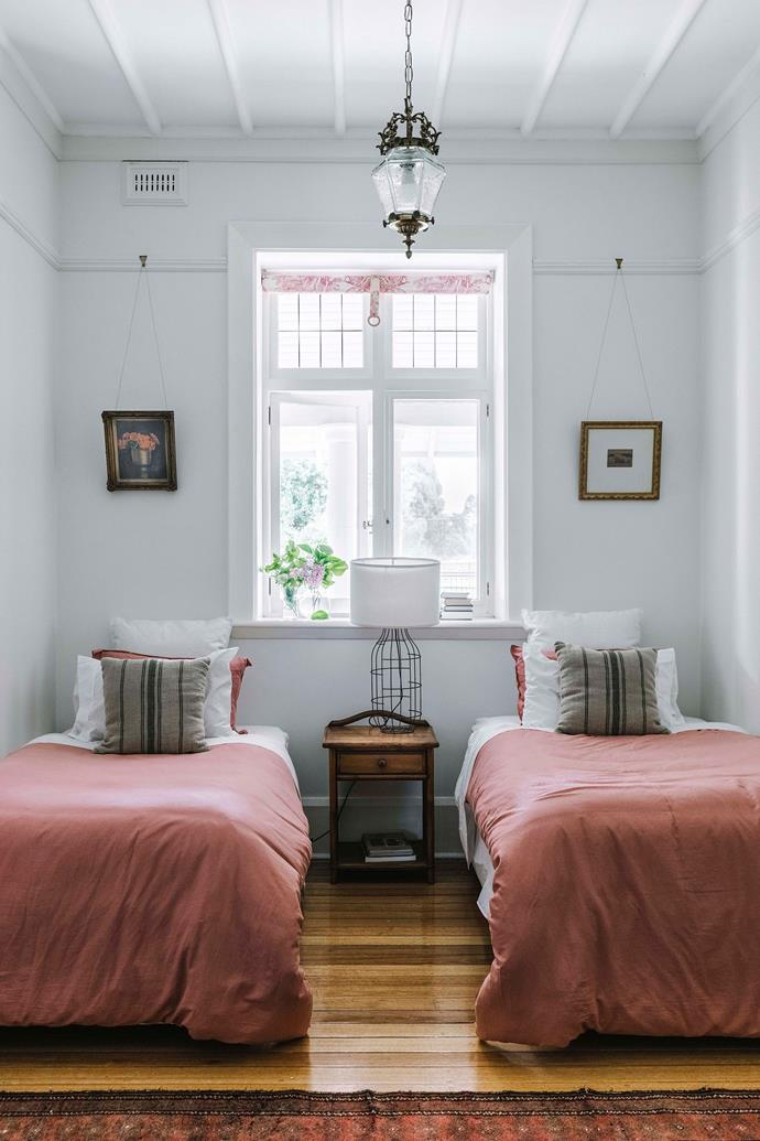 Twin beds dressed with pink bedding in the spare room.