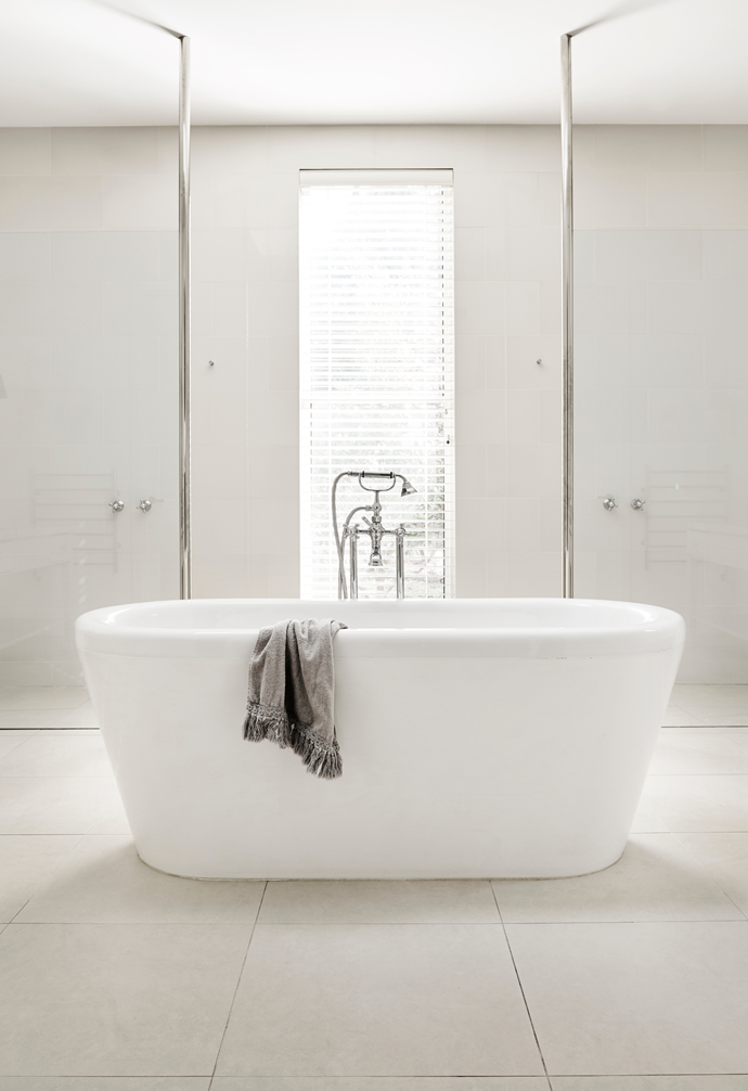 The couple's luxurious ensuite, featuring a stylish Carrara marble vanity and an oversized freestanding bath, is exactly as the home's previous owners designed it.